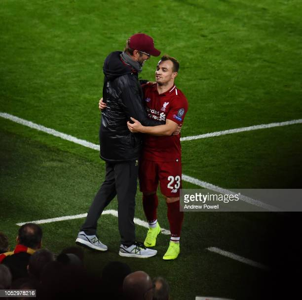 Jurgen Klopp manager of Liverpool with Xherdan Shaqiri during the Group C match of the UEFA Champions League between Liverpool and FK Crvena Zvezda...
