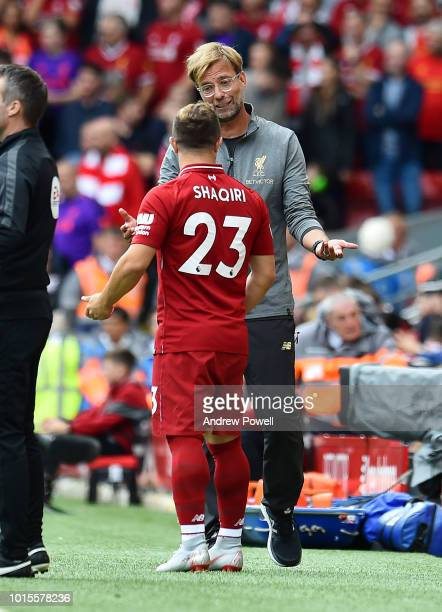 Jurgen Klopp manager of Liverpool with Xherdan Shaqiri during the Premier League match between Liverpool FC and West Ham United at Anfield on August...