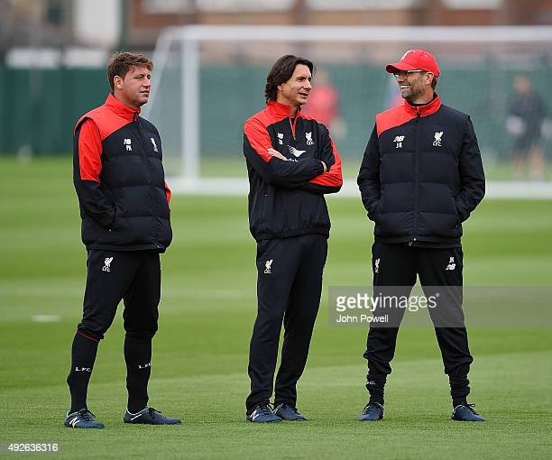 Jurgen Klopp manager of Liverpool with Zeljko Buvac assistant manager of Liverpool and Peter Krawietz first team coach of Liverpool during a training...
