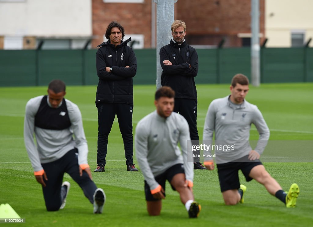 Jurgen Klopp manager of Liverpool with Zeljko Buvac First assistant coach of Liverpool during a training session at Melwood Training Ground on September 12, 2017 in Liverpool, United Kingdom.