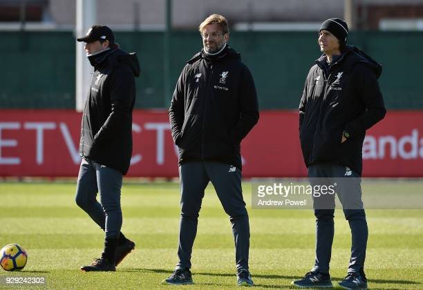 Jurgen Klopp manager of Liverpool with Zeljko Buvac First assistant coach and Peter Krawietz Second assistant coach during a training session at...