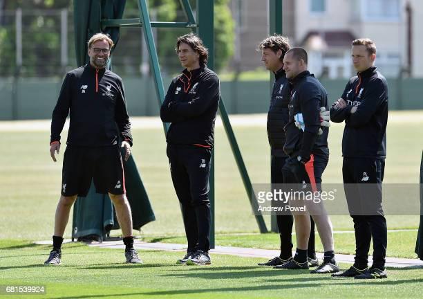 Jurgen Klopp manager of Liverpool with Zeljko Buvac Peter Krawietz John Achterberg and Pepijn Lijnders of Liverpool during a training session at...