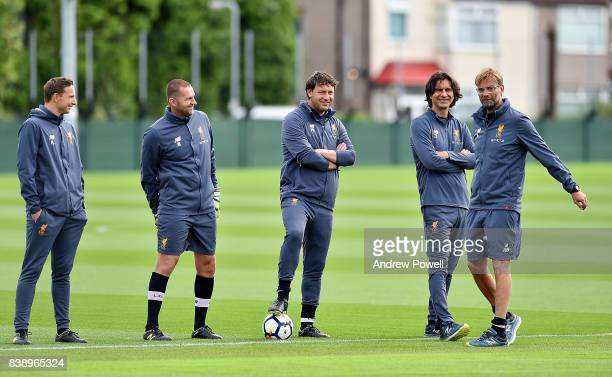 Jurgen Klopp manager of Liverpool with Zeljko Buvac Peter Krawietz John Achterberg Pepijn Lijnders of Liverpool during a training session at Melwood...