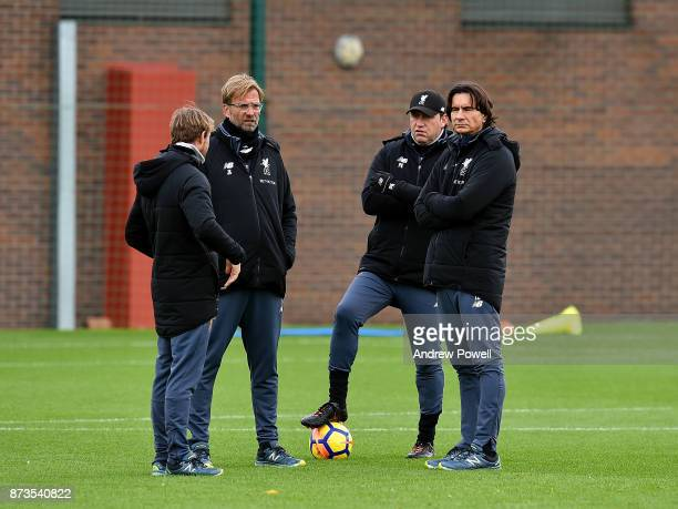 Jurgen Klopp manager of Liverpool Zeljko Buvac first assistant coach of Liverpool and Peter Krawietz second assistant coach during a training session...