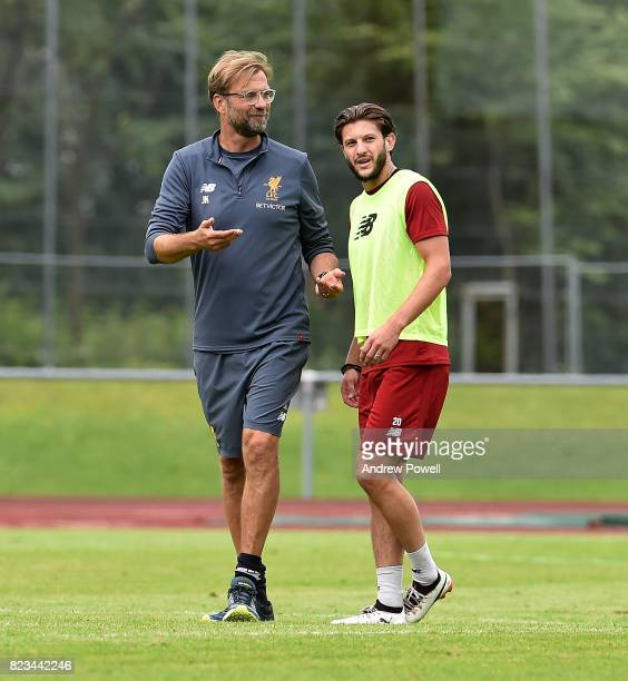Jurgen Klopp manager talking with Adam Lallana of Liverpool during a training session at RottachEgern on July 27 2017 in Munich Germany