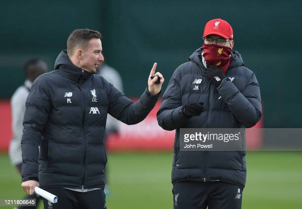 Jurgen Klopp manager with Pepijn Lijnders of Liverpool during a training session at Melwood on March 10 2020 in Liverpool United Kingdom Liverpool FC...