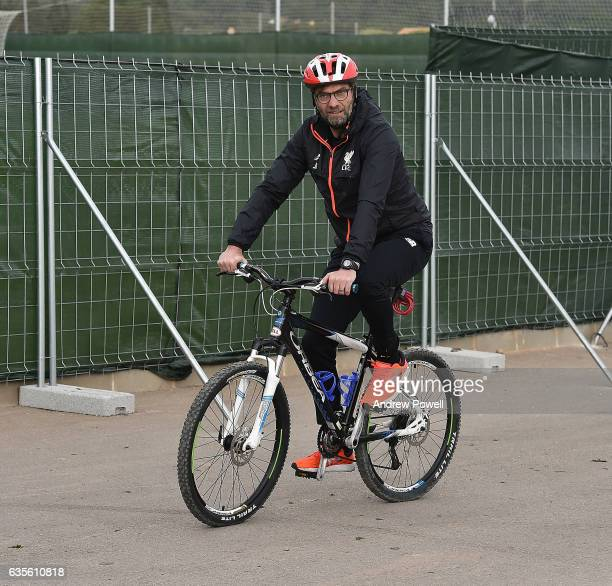 Jurgen Klopp manger of Liverpool arrives on a bike before the training session at La Manga on February 16 2017 in La Manga Spain