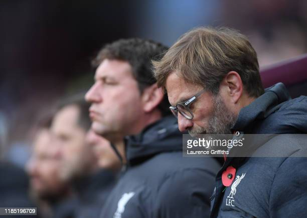 Jurgen Klopp Manger of Liverpool Assistant Manager Peter Krawietz and their staff observe a minutes silence for Remembrance Day ahead of the Premier...