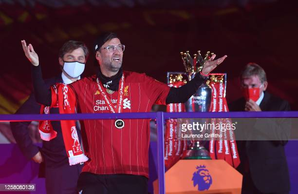 Jurgen Klopp Manger of Liverpool puts on his winners medal after being presented by Richard Masters Chief Executive of the Premier League and...