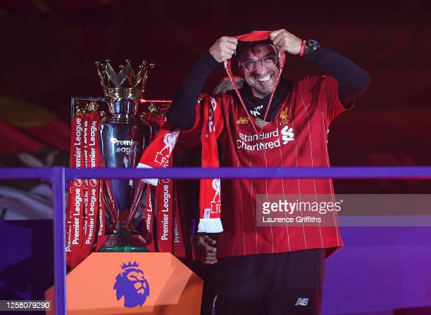 Jurgen Klopp Manger of Liverpool puts on his winners medal during the presentation ceremony of the Premier League match between Liverpool FC and...