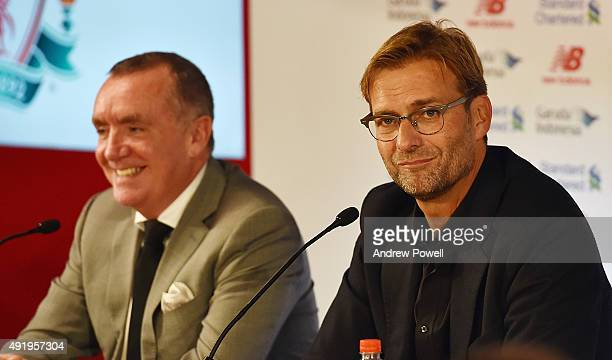 Jurgen Klopp new manager of Liverpool with Ian Ayre chief executive officer of Liverpool football during a press conference at Anfield on October 9,...