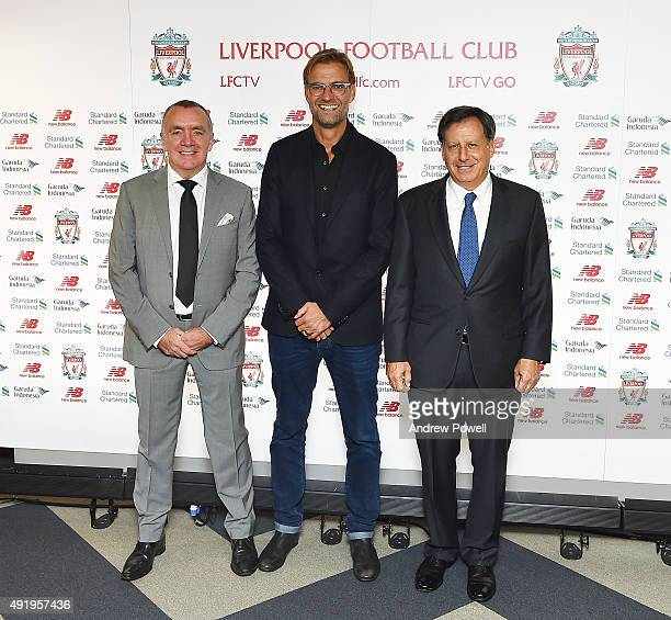 Jurgen Klopp new manager of Liverpool with Tom Werner part owner of Liverpool and Ian Ayre chief executive officer of Liverpool football pose for a...