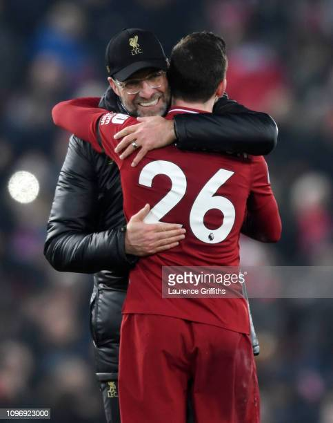 Jurgen Klopp of Liverpool celebrates victory with Andrew Robertson after the Premier League match between Liverpool FC and Crystal Palace at Anfield...