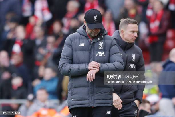 Jurgen Klopp of Liverpool checks his watch as the game reaches 90 minutes during the Premier League match between Liverpool FC and AFC Bournemouth at...