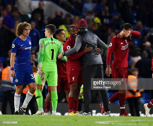 Jurgen Klopp of Liverpool embraces Daniel Sturridge at the end of the Premier League match between Chelsea FC and Liverpool FC at Stamford Bridge on...