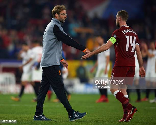 Jurgen Klopp of Liverpool FC shake hands with Jordan Henderson of Liverpool FC after the end of the UEFA Champions League group E match between...