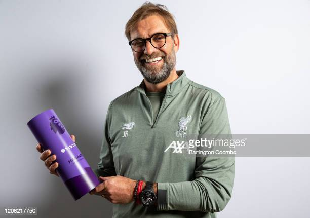 Jurgen Klopp of Liverpool Football Club is Presented with the Barclays Premier League Manager of the Month for January at Melwood Training Ground on...