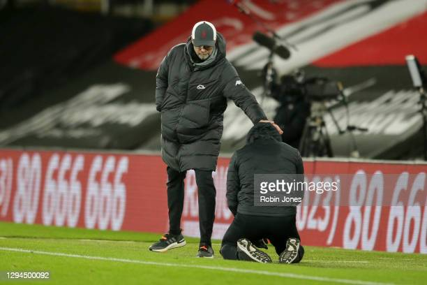 Jurgen Klopp of Liverpool looks on as Ralph Hasenhuttl of Southampton drops to his knees after his sides 1-0 win during the Premier League match...