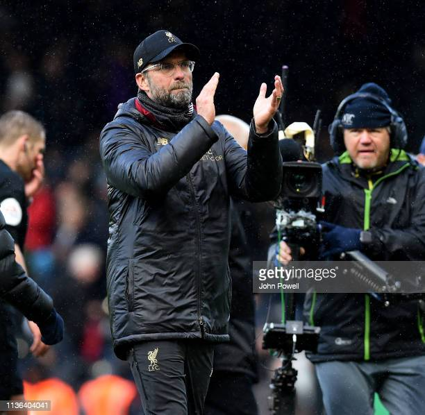 Jurgen Klopp of Liverpool shows his appreciation to the fans at the end of the Premier League match between Fulham FC and Liverpool FC at Craven...