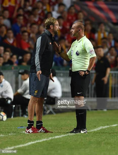Jurgen Klopp of Liverpool talks with Referee Bobby Madley during the Premier League Asia Trophy match between Liverpool FC and Leicester City FC at...
