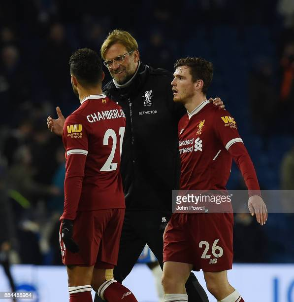 Jurgen Klopp of Liverpool with Alex OxladeChamberlain and Andrew Robertson at the end the Premier League match between Brighton and Hove Albion and...
