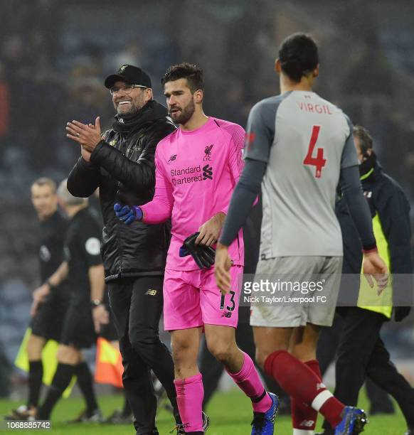 Jurgen Klopp of Liverpool with Alisson Becker at the end of the Premier League match between Burnley FC and Liverpool FC at Turf Moor on December 5...