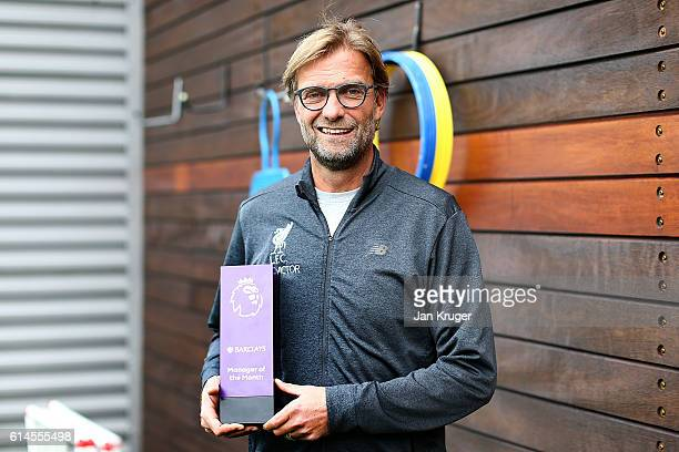 Jurgen Klopp poses with the manager of the month trophy at Melwood Training Ground on October 13 2016 in Liverpool England