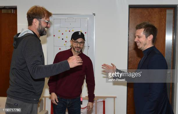 Jurgen Klopp Signs A Contract Extension and chats with Sporting Director Michael Edwards and Mike Gordon FSG President and Liverpool FC owner at...