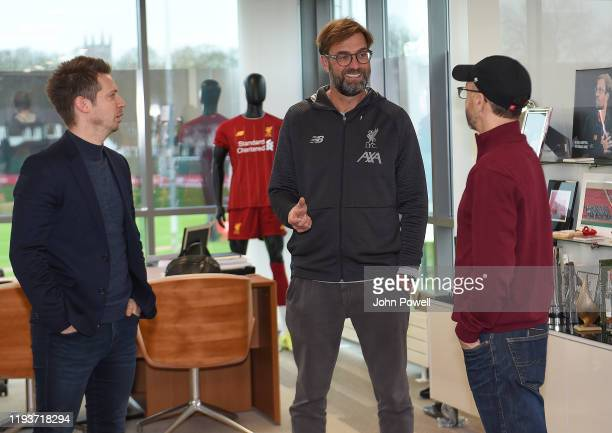 Jurgen Klopp Signs A Contract Extension and chats with Sporting Director Michael Edwards and Mike Gordon FSG President and Liverpool F.C owner at...