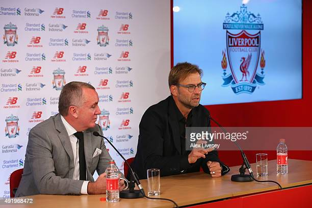 Jurgen Klopp sits alongside the chief executive Ian Ayre as he is unveiled as the new manager of Liverpool FC during a press conference at Anfield on...