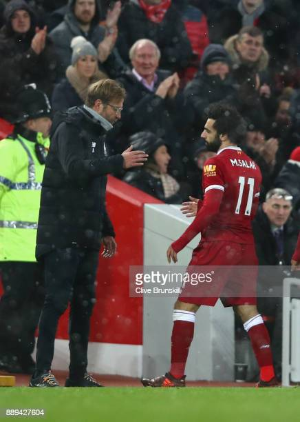 Jurgen Klopp speaks with Mohamed Salah of Liverpool during the Premier League match between Liverpool and Everton at Anfield on December 10 2017 in...
