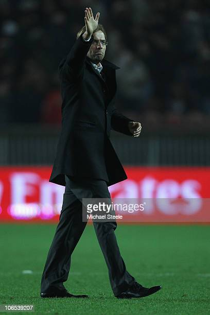 Jurgen Klopp the Borussia coach applauds the travelling supporters after the final whistle during the UEFA Europa League Group J match between Paris...