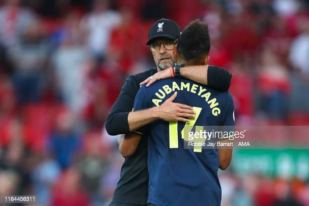 Jurgen Klopp the head coach / manager of Liverpool and PierreEmerick Aubameyang of Arsenal during the Premier League match between Liverpool FC and...