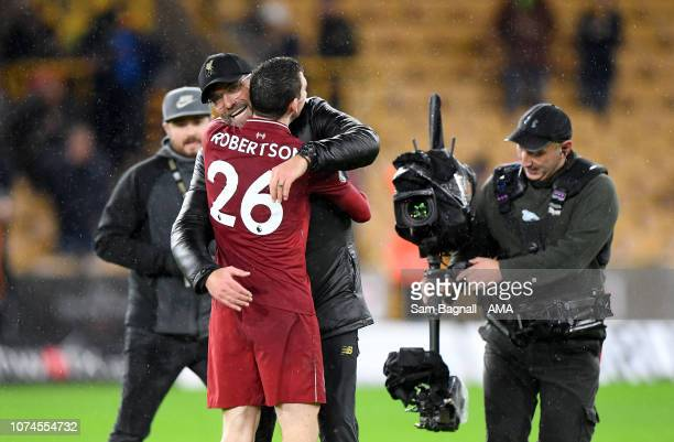 Jurgen Klopp the head coach / manager of Liverpool celebrates at full time with Andrew Robertson of Liverpool during the Premier League match between...