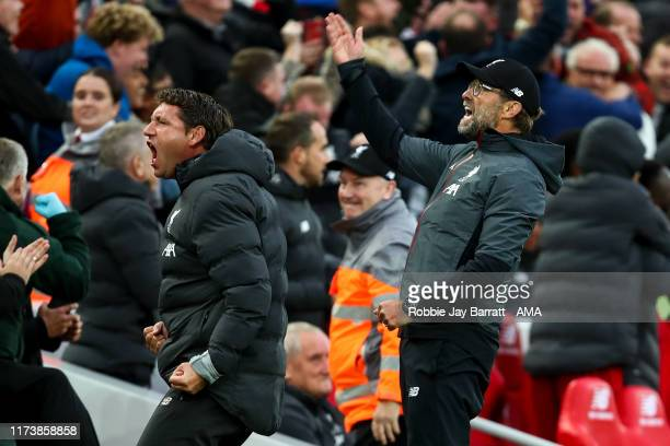 Jurgen Klopp the head coach / manager of Liverpool celebrates with Peter Krawietz the assistant head coach / manager of Liverpool during the Premier...