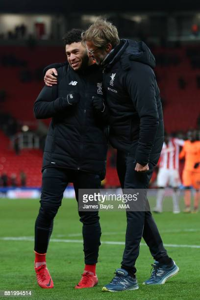 Jurgen Klopp the head coach / manager of Liverpool embraces Alex OxladeChamberlain of Liverpool at full time after the Premier League match between...