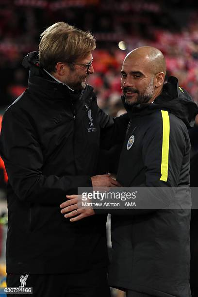 Jurgen Klopp the head coach / manager of Liverpool greets Josep Guardiola the head coach / manager of Manchester City during the Premier League match...