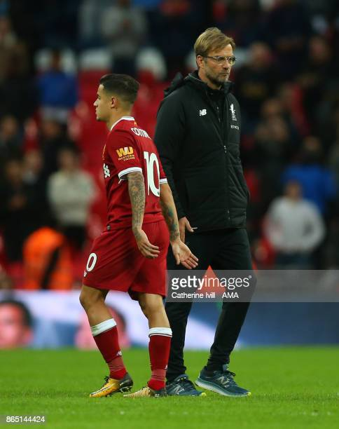 Jurgen Klopp the head coach / manager of Liverpool walks past Philippe Coutinho of Liverpool during the Premier League match between Tottenham...
