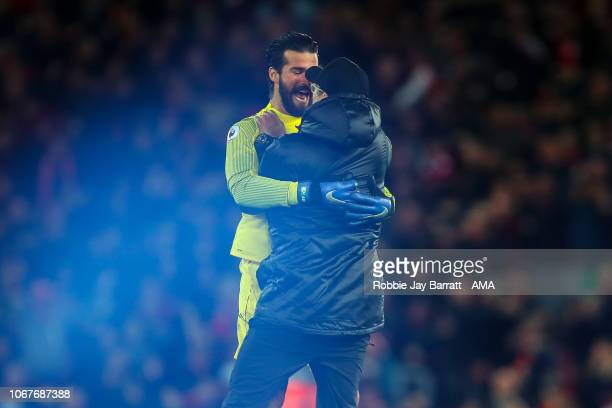 Jurgen Klopp the manager / head coach of Liverpool celebrates with Alisson Becker of Liverpool as Divock Origi of Liverpool scores a goal to make it...