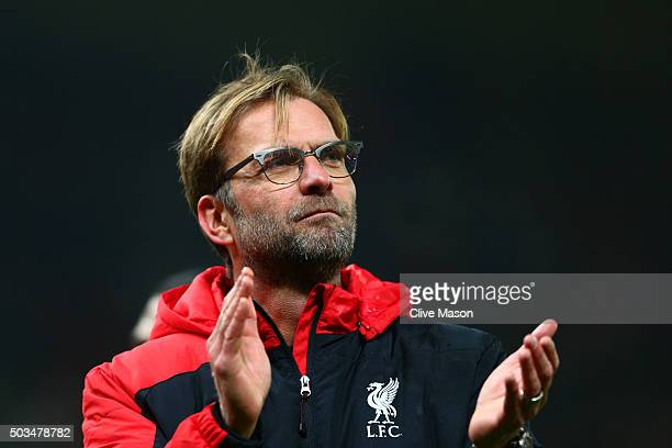 Jurgen Klopp the Manager of Liverpool applauds the fans following their team's 10 victory during the Capital One Cup semi final first leg match...