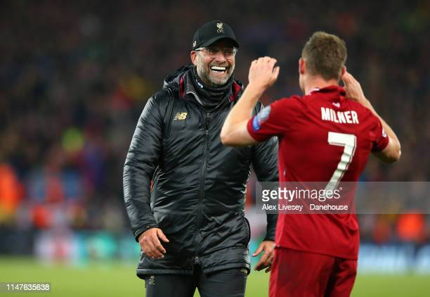 Jurgen Klopp the manager of Liverpool celebrates with James Milner after the UEFA Champions League Semi Final second leg match between Liverpool and...