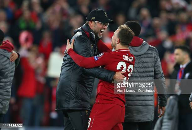 Jurgen Klopp the manager of Liverpool celebrates with Xherdan Shaqiri after the UEFA Champions League Semi Final second leg match between Liverpool...