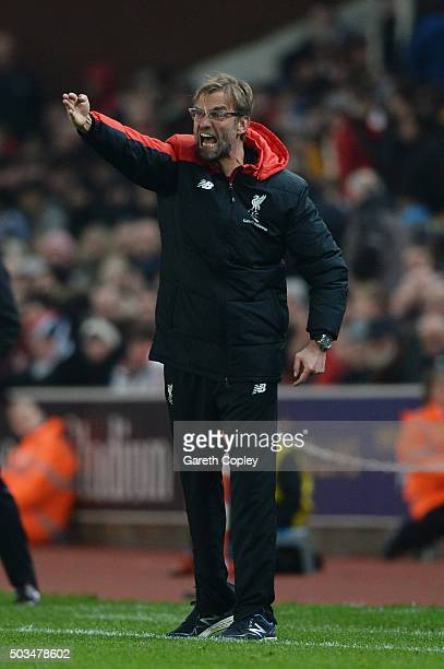Jurgen Klopp the Manager of Liverpool directs his players during the Capital One Cup semi final first leg match between Stoke City and Liverpool at...