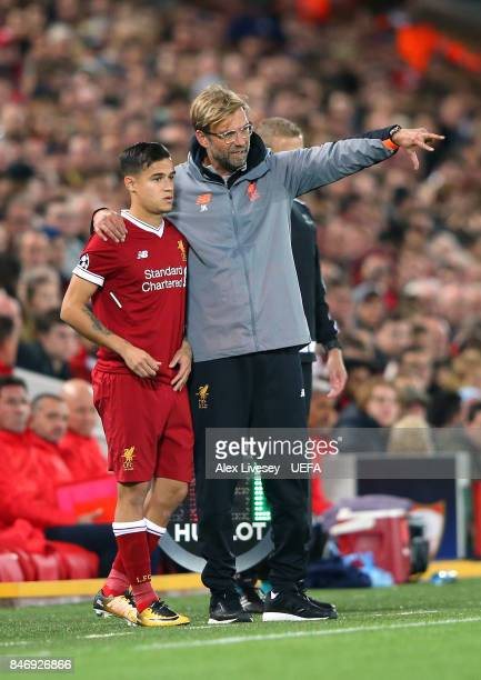 Jurgen Klopp the manager of Liverpool FC talks with Philippe Coutinho during the UEFA Champions League group E match between Liverpool FC and Sevilla...