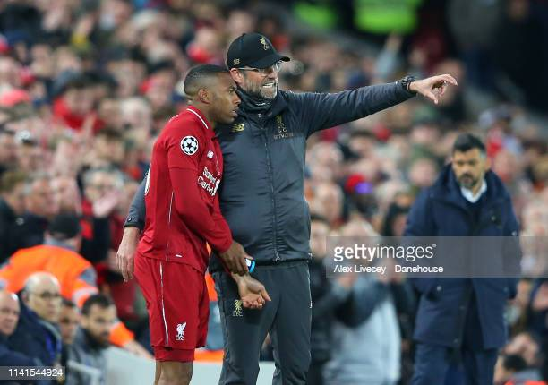 Jurgen Klopp the manager of Liverpool gives instructions to Daniel Sturridge during the UEFA Champions League Quarter Final first leg match between...