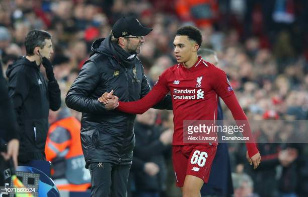 Jurgen Klopp the manager of Liverpool shakes hands with Trent AlexanderArnold after he was substituted during the UEFA Champions League Group C match...