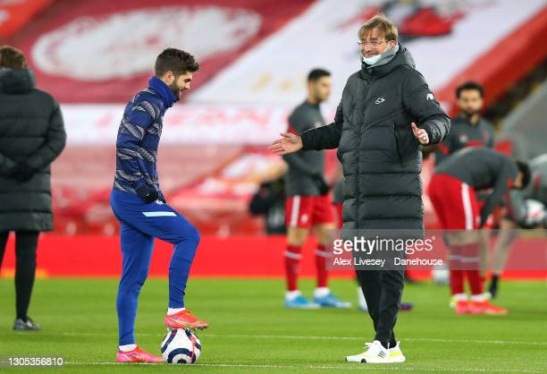 Jurgen Klopp the manager of Liverpool talks with Christian Pulisic of Chelsea prior to the Premier League match between Liverpool and Chelsea at...
