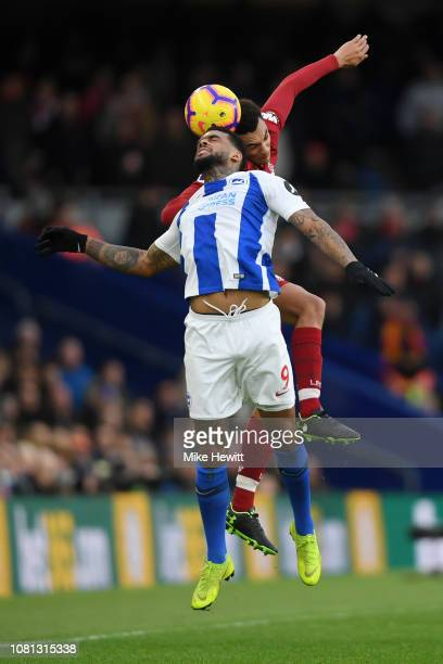 Jurgen Locadia of Brighton and Hove Albion and Trent AlexanderArnold of Liverpool competes for a header during the Premier League match between...