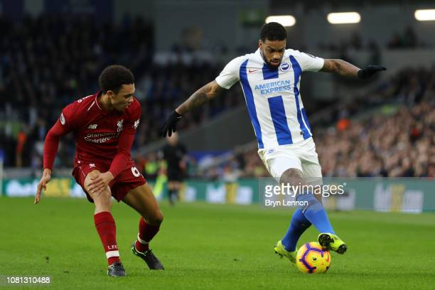 Jurgen Locadia of Brighton and Hove Albion battles for possession with Trent AlexanderArnold of Liverpool during the Premier League match between...