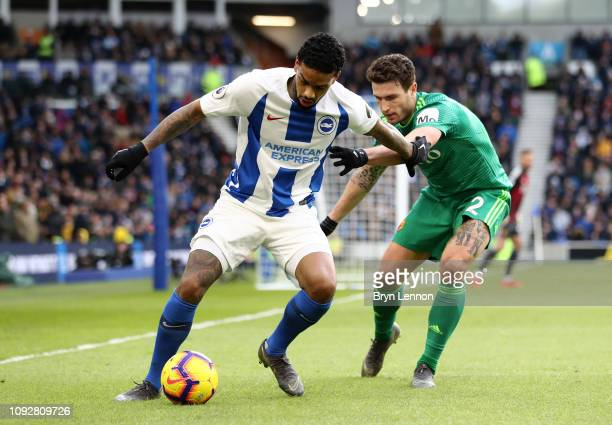 Jurgen Locadia of Brighton and Hove Albion is challenged by Daryl Janmaat of Watford during the Premier League match between Brighton Hove Albion and...
